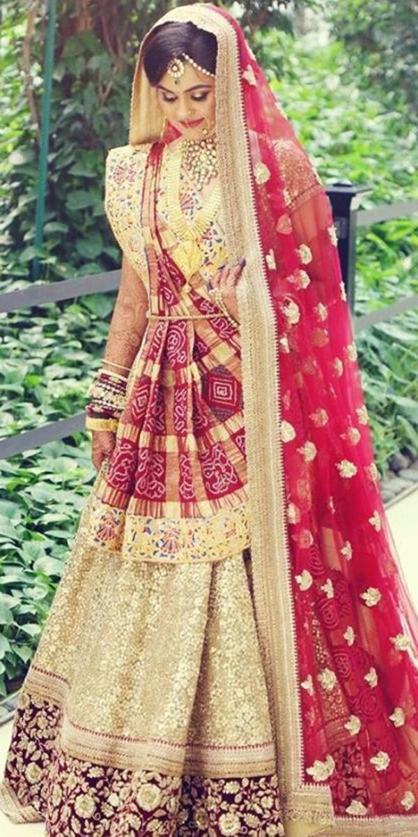 indian wedding dresses gold red gujarati israni photography