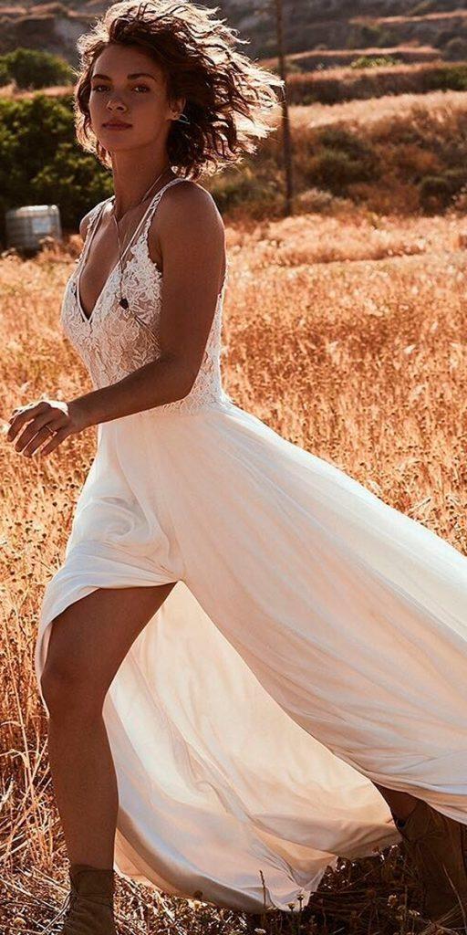 western wedding dresses straight flowy lace spaghetti straps v neckline with slit and boots by lillian west