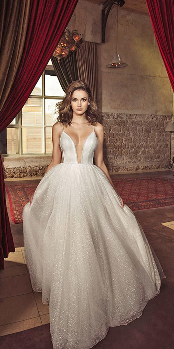 a line with full skirt and deep neckline and spaghetti strap julie vino wedding dresses