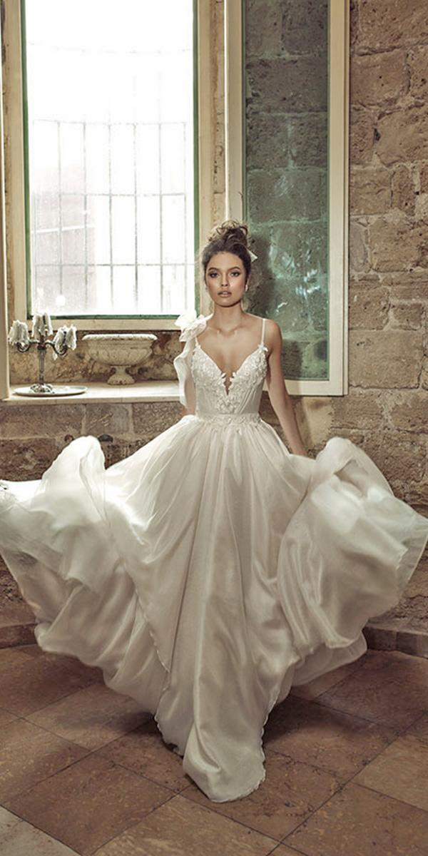 a line full skirt with deep neckline and spaghetti strap julie vino wedding dresses
