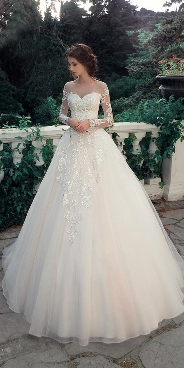 ball gown with embroidered lace and illusion sweetheart neck and long illusion sleeves milva wedding dresses