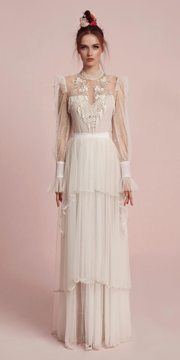 high neckline with long sleeves an floral details and keyhole lior charchy wedding dresses