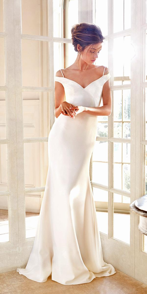 ivory trumpet with off shoulder neckline and train tara keely wedding dresses