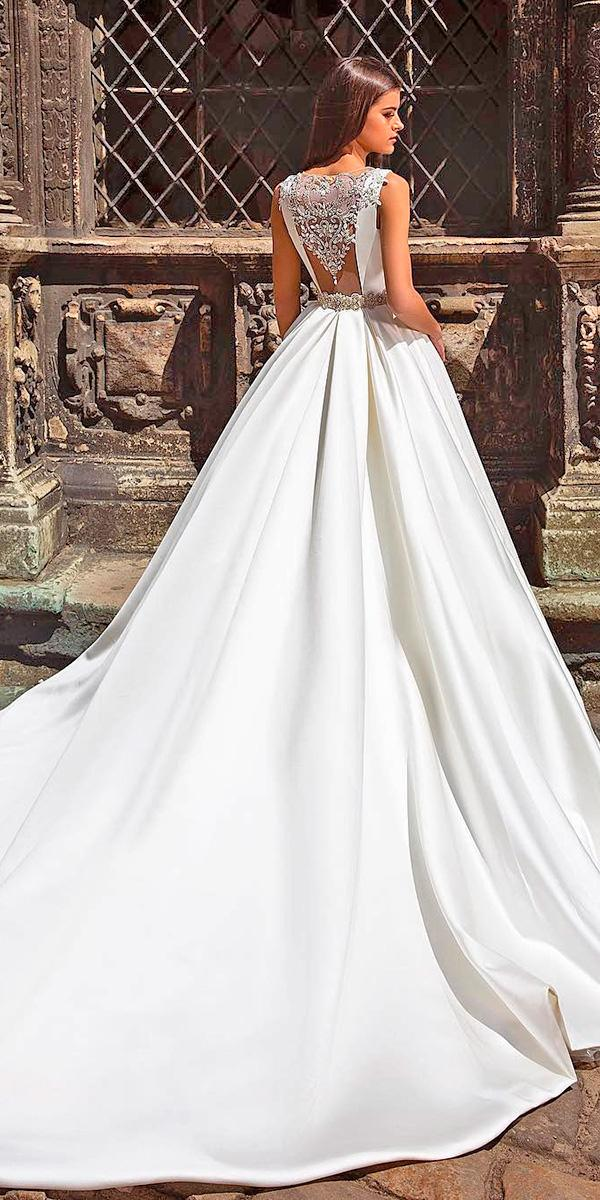 a line with unique back with beading crystals and train crystal design wedding dresses