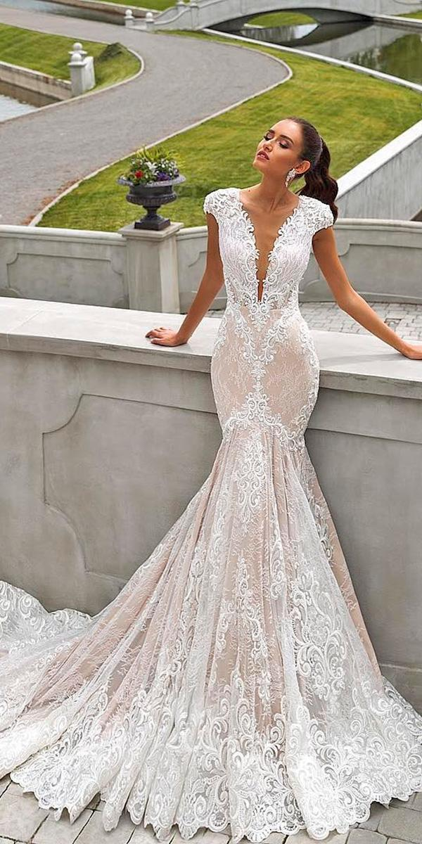 lace mermaid with deep v neckline and cap sleeves with train crystal design wedding dresses