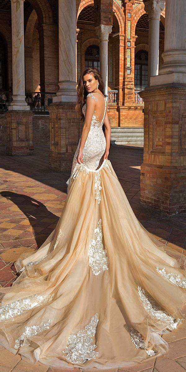 nude sheath with over skirt and deep backless with train crystal design wedding dresses