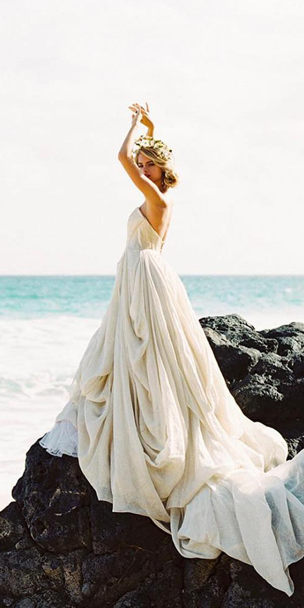 24 romantic bridal gowns perfect for any love story for Simple romantic wedding dresses