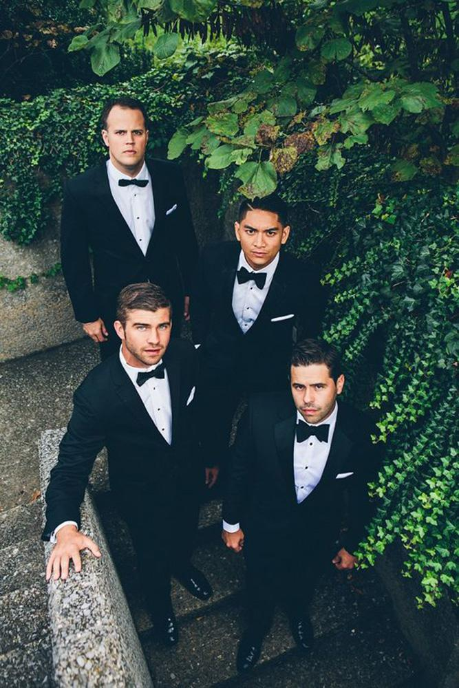classic groomsmen attire black jackets with butterfly high fiv For love