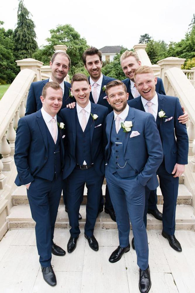 groomsmen attire navy jackets with pink tie julie michaelsen photography