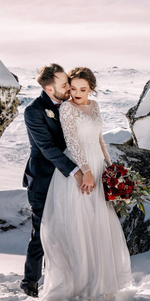 a line flowy lace long sleeve with embellishment what to wear to a winter wedding featherandfinch