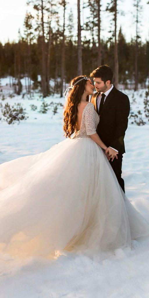 ball gown layered skirt ivory lace sleeves low back what to wear to a winter wedding radionphotography