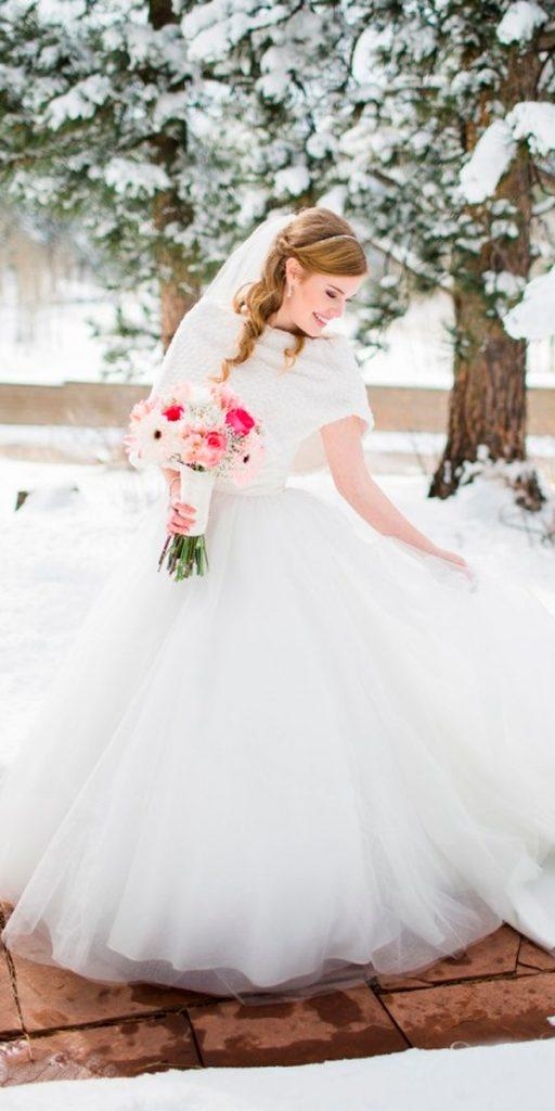 what to wear to a winter wedding ball gown layered skirt with knitted cape sheamcgrath