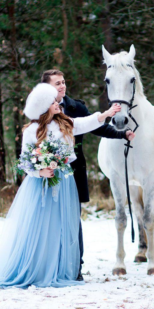 what to wear to a winter wedding blue ball gown color with fur hat anastasia marchenko