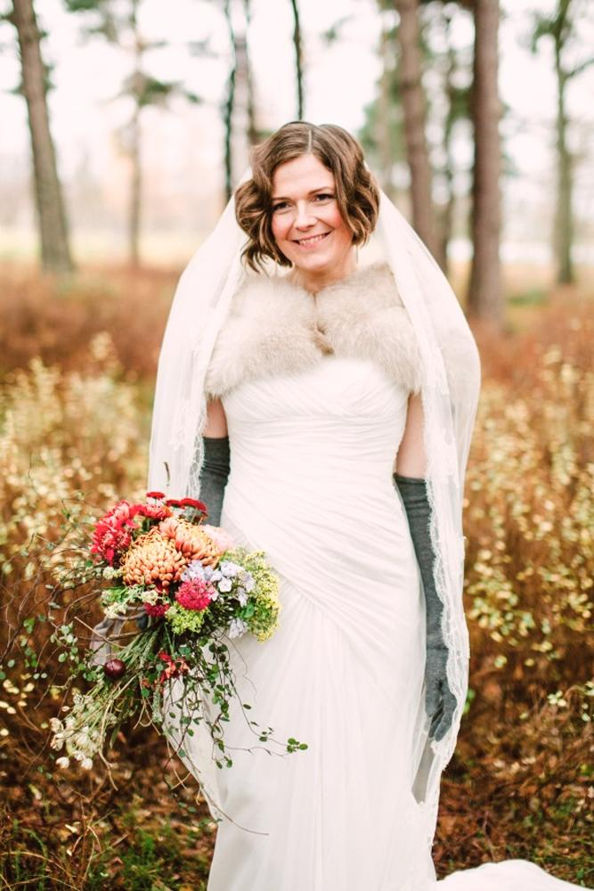 what to wear to a winter wedding vintage dress with gloves fur camilla jorvad